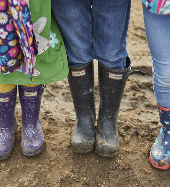 wellies in the mud at sky park farm become a deer friend