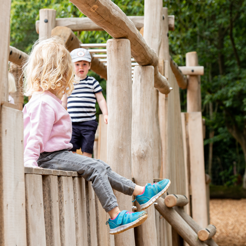 Children exploring the Adventure Playground at Sky Park Farm